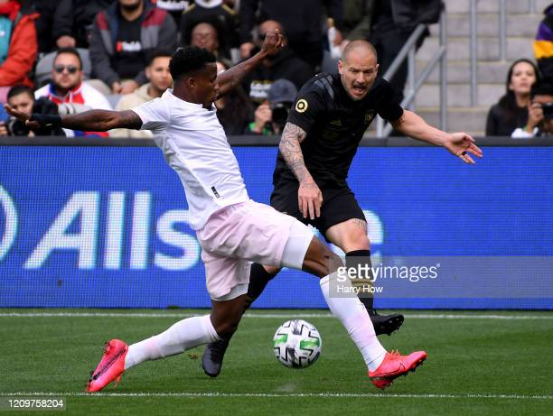 Jordan Harvey of Los Angeles FC reacts as his cross is blocked by Alvas Powell of Inter Miami CF during the first half at Banc of California Stadium...