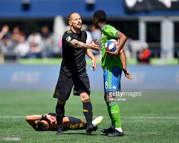 Jordan Harvey of the Los Angeles FC and Victor Rodriguez of Seattle Sounders try to stake claim of the ball during the match at CenturyLink Field on...