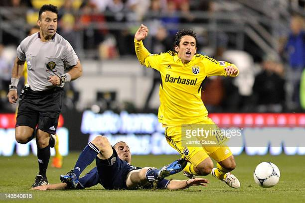 Jordan Harvey of the Vancouver Whitecaps takes down Milovan Mirosevic of the Columbus Crew with a tackle in the second half on April 28 2012 at Crew...