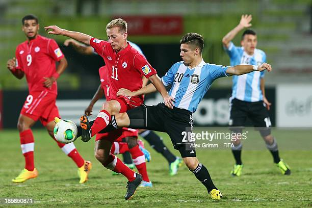 Jordan Haynes of Canada is challenged by Matias Sanchez of Argentina during the FIFA U-17 World Cup UAE 2013 Group E match between Argentina and...
