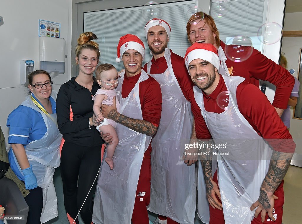 Jordan Henderson, Adam Bogdan, Danny Ings and Philippe Coutinho of Liverpool at their annual visit at Alder Hey Childrens Hospital on December 11, 2017 in Liverpool, England.