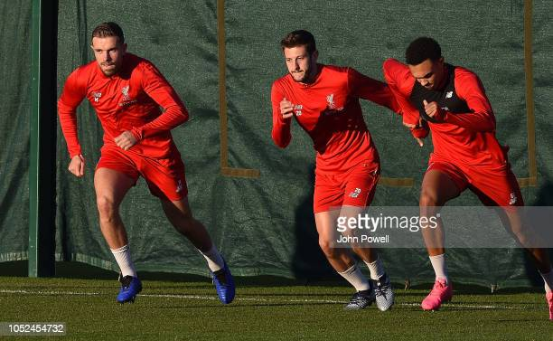 Jordan Henderson Adam Lallana and Trent AlexanderArnold of Liverpool during a training session at Melwood Training Ground on October 18 2018 in...