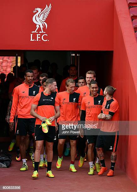 Jordan Henderson Alberto Moreno Roberto Firmino and Lucas Leiva of Liverpool during a training session at Anfield on September 8 2016 in Liverpool...