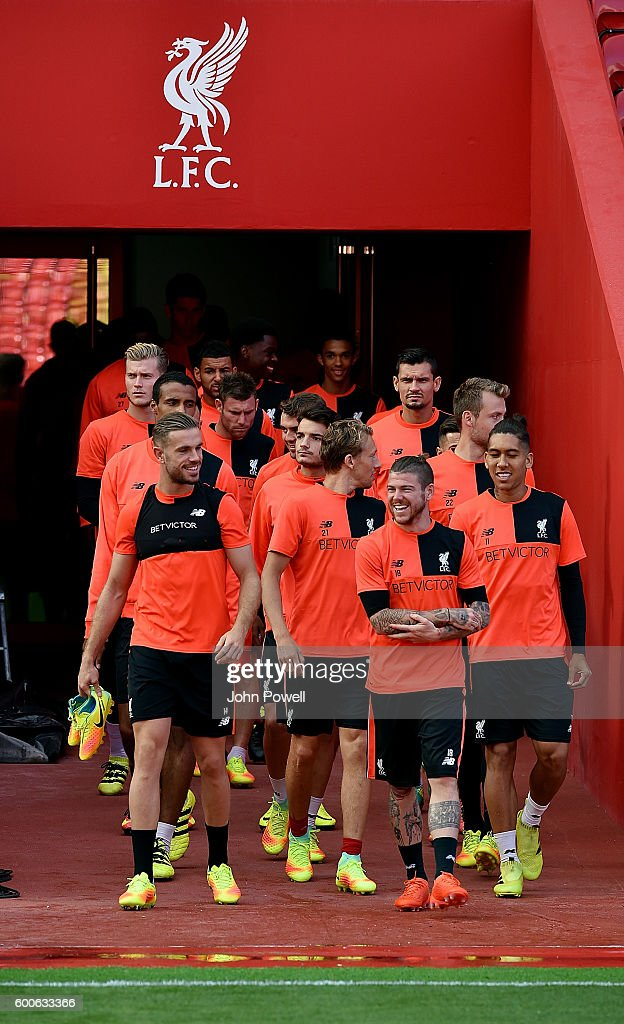 Jordan Henderson, Alberto Moreno, Roberto Firmino and Lucas Leiva of Liverpool during a training session at Anfield on September 8, 2016 in Liverpool, England.