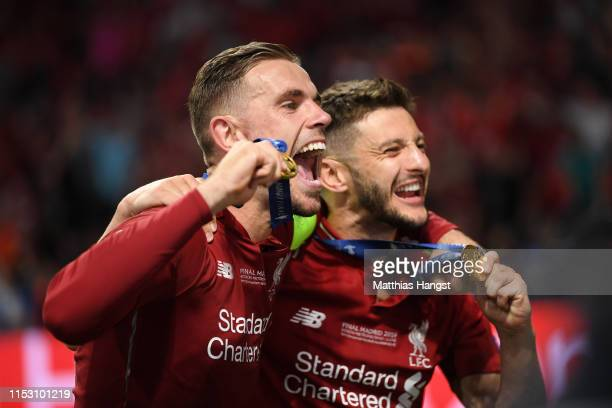 Jordan Henderson and Adam Lallana of Liverpool celebrate victory after the UEFA Champions League Final between Tottenham Hotspur and Liverpool at...