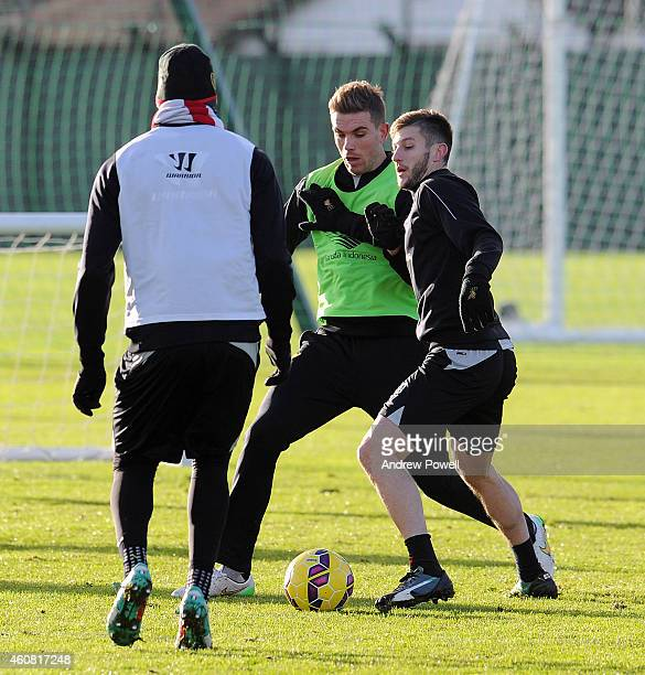 Jordan Henderson and Adam Lallana of Liverpool during a training session at Melwood Training Ground on December 24 2014 in Liverpool England