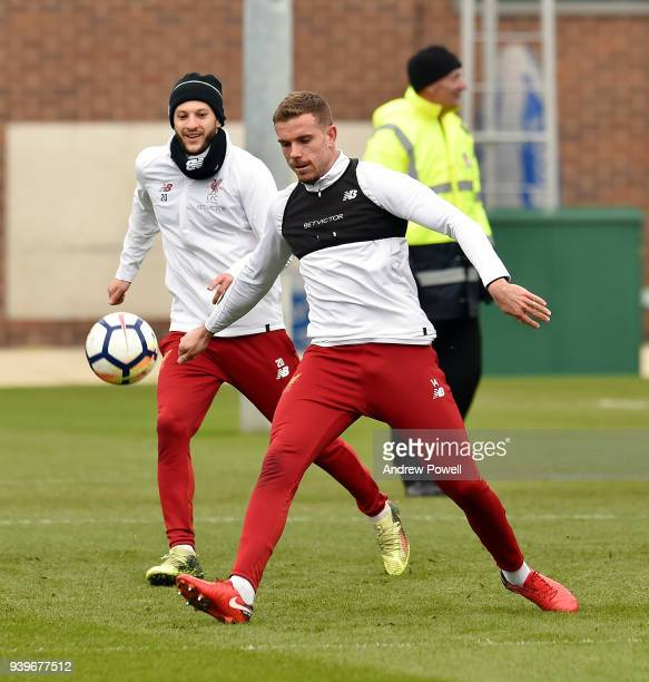 Jordan Henderson and Adam Lallana of Liverpool during a training session at Melwood Training Ground on March 29 2018 in Liverpool England