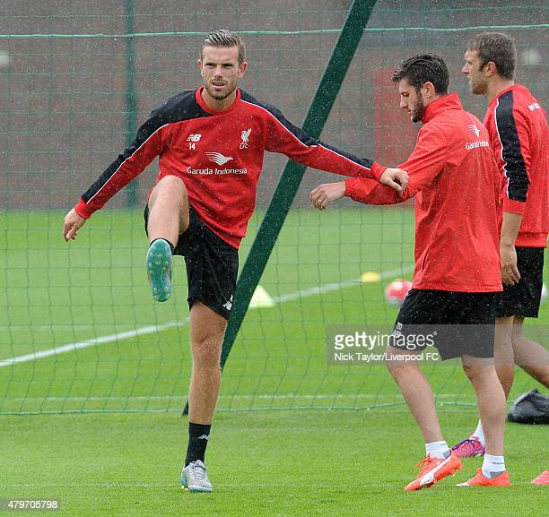 Jordan Henderson and Adam Lallana warm up as Liverpool players return for preseason training at Melwood Training Ground on July 6 2015 in Liverpool...