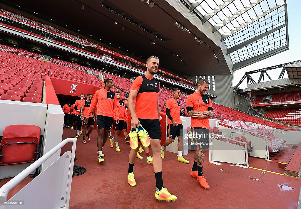 Jordan Henderson and Alberto Moreno of Liverpool during a training session at Anfield on September 8, 2016 in Liverpool, England.