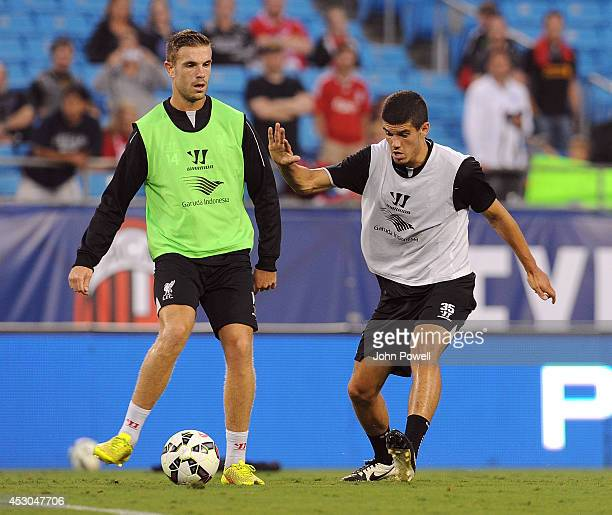 Jordan Henderson and Conor Coady of Liverpool in action during a open training session at Bank Of America Stadium on August 1 2014 in Charlotte North...