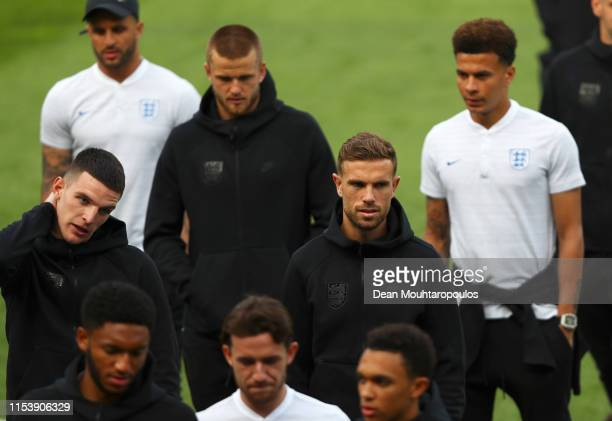 Jordan Henderson and Declan Rice walk on the pitchwith team mates during England media access on the eve of their UEFA Nations League match against...