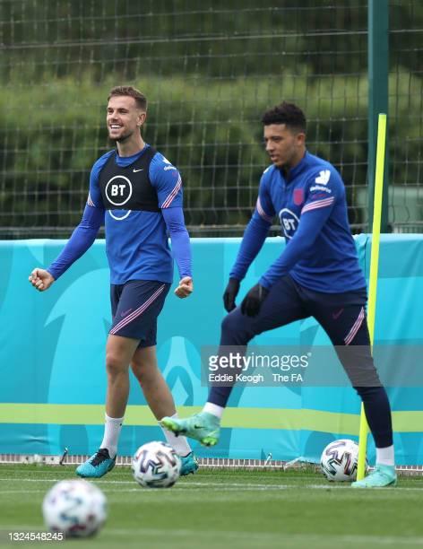 Jordan Henderson and Jadon Sancho of England look on at Tottenham Hotspur Training Ground on June 20, 2021 in Burton upon Trent, England.