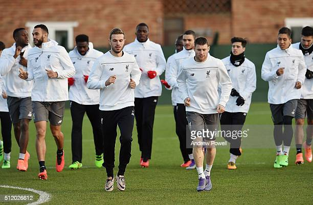 Jordan Henderson and James Milner of Liverpool lead the training session at Melwood Training ground on February 24 2016 in Liverpool United Kingdom