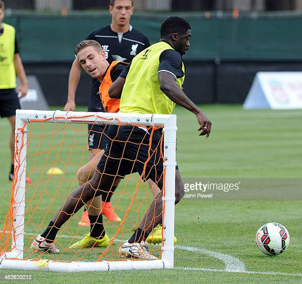 Jordan Henderson and Kolo Toure of Liverpool in action during a training session at Harvard Univarsity on July 24 2014 in Cambridge Massachusetts