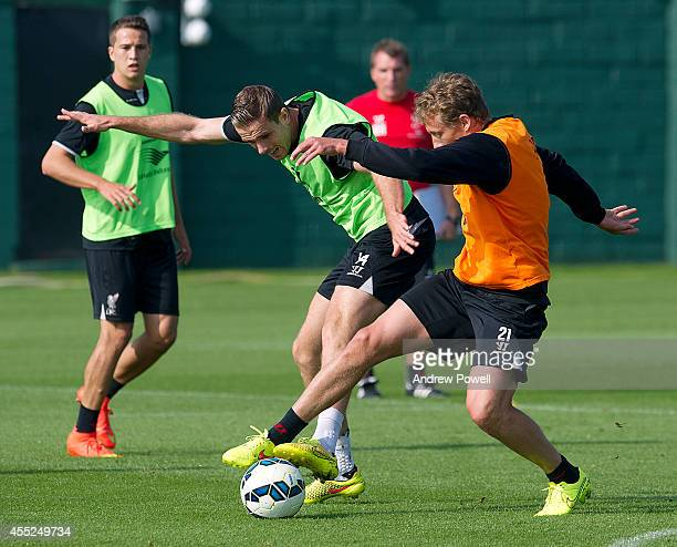 Jordan Henderson and Lucas Leiva of Liveprool in action during a training session at Melwood Training Ground on September 11 2014 in Liverpool England