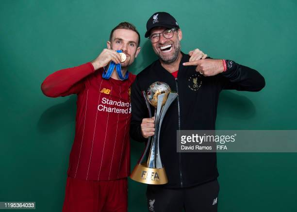 Jordan Henderson and Manager Jurgen Klopp of Liverpool pose with the Club World Cup trophy after the FIFA Club World Cup Qatar 2019 Final match...