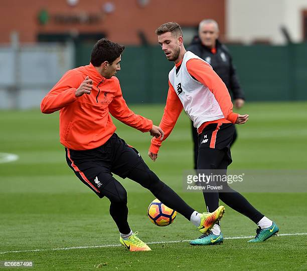 Jordan Henderson and Marko Grujic of Liverpool during a training session at Melwood Training Ground on November 30 2016 in Liverpool England