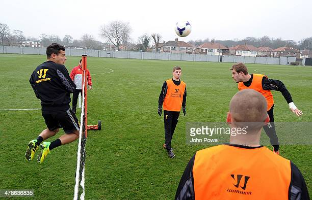 Jordan Henderson and Philippe Coutinho of Liverpool in action during a training session at Melwood Training Ground on March 14 2014 in Liverpool...