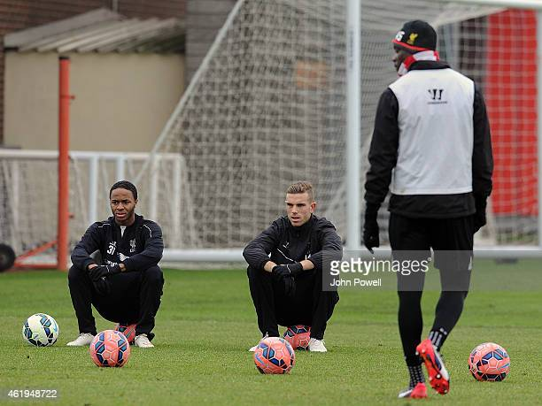 Jordan Henderson and Raheem Sterling of Liverpool in ation during a training session at Melwood Training ground on January 22 2015 in Liverpool...
