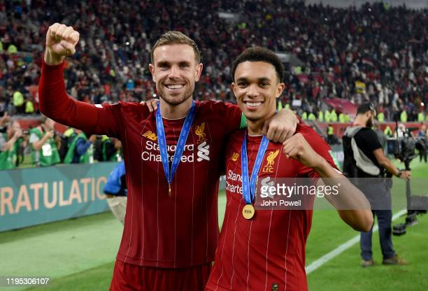 Jordan Henderson and Trent AlexanderArnold of Liverpool at the end after winning the FIFA Club World Cup final match between Liverpool FC and CR...