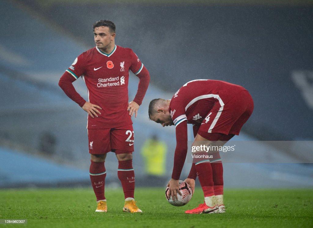 Jordan Henderson and Xherdan Shaqiri of Liverpool line up a free kick...  News Photo - Getty Images