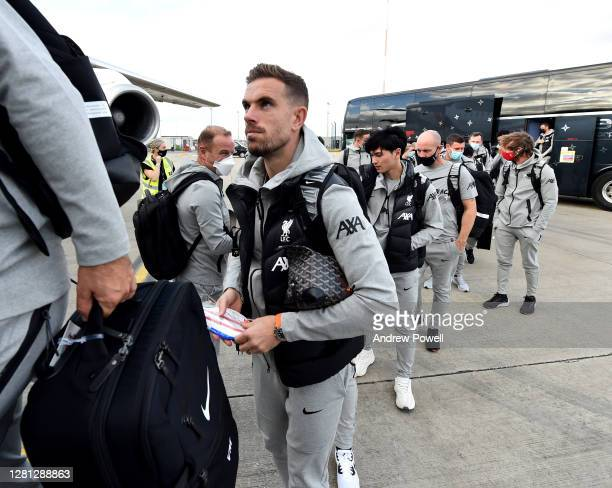 Jordan Henderson captain of Liverpool boarding a plane ^ahead of the UEFA Champions League Group D stage match between Liverpool FC and Ajax...