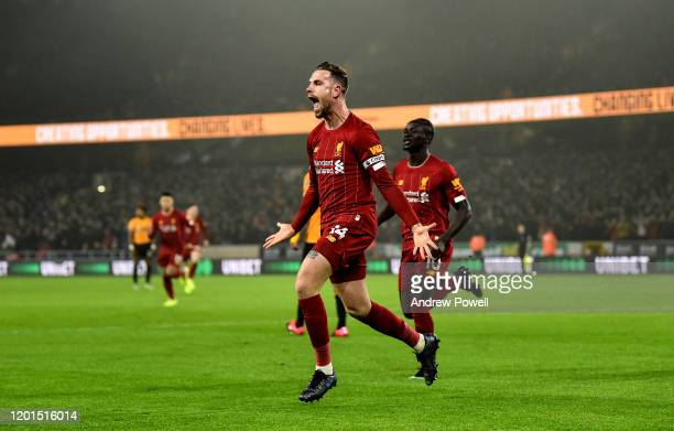 Jordan Henderson captain of Liverpool celebrates after scoring the opening goal during the Premier League match between Wolverhampton Wanderers and...