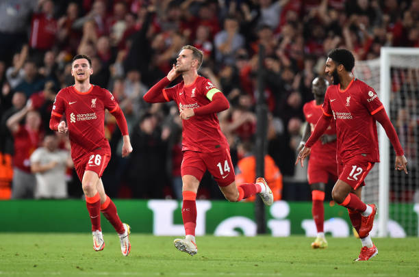 Jordan Henderson captain of Liverpool celebrates after scoring the third goal during the UEFA Champions League group B match between Liverpool FC and...