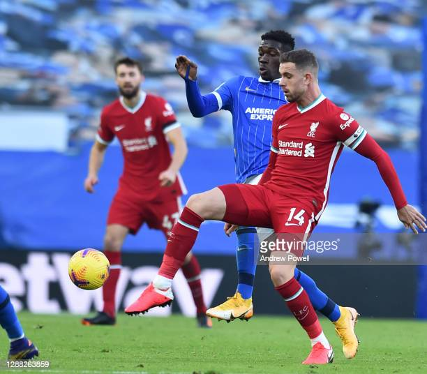 Jordan Henderson captain of Liverpool during the Premier League match between Brighton & Hove Albion and Liverpool at American Express Community...