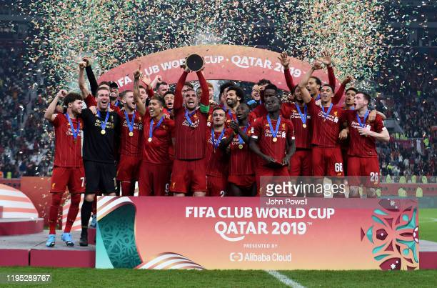 Jordan Henderson captain of Liverpool lifting the FIFA Club World Cup at the end of the the FIFA Club World Cup final match between Liverpool FC and...