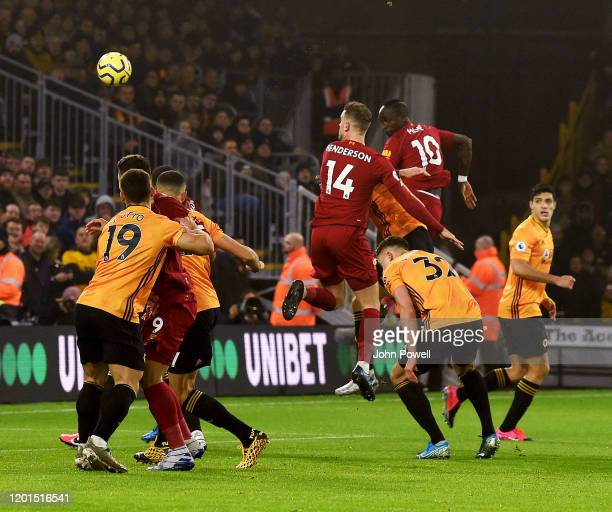 Jordan Henderson captain of Liverpool scores the opening goal during the Premier League match between Wolverhampton Wanderers and Liverpool FC at...