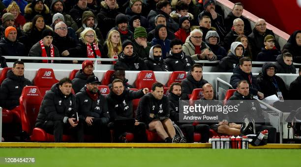 Jordan Henderson captain of Liverpool watching from the back of the bench during the Premier League match between Liverpool FC and West Ham United at...