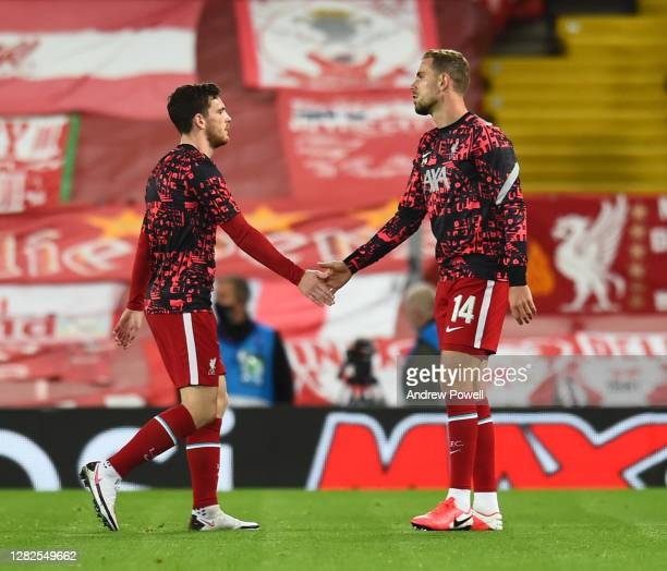 Jordan Henderson captain of Liverpool with Andy Robertson of Liverpool before the UEFA Champions League Group D stage match between Liverpool FC and...