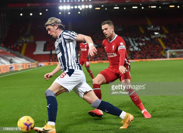 Jordan Henderson captain of Liverpool with Conor Gallagher of West Bromwich Albion during the Premier League match between Liverpool and West...