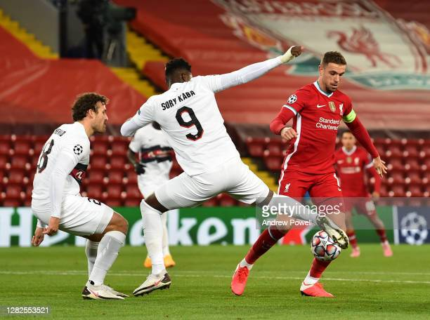 Jordan Henderson captain of Liverpool with Sory Kaba of FC Midtjylland during the UEFA Champions League Group D stage match between Liverpool FC and...