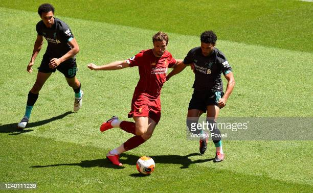 Jordan Henderson captain of Liverpool with Trent AlexanderArnold and Alex OxladeChamberlain of Liverpool during a training session at Anfield on June...
