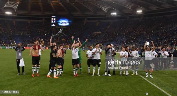 Jordan Henderson Dejan Lovren Ragnar Klavan and James Milner and the rest of the Liverpool players celebrate the victory at the end of the UEFA...