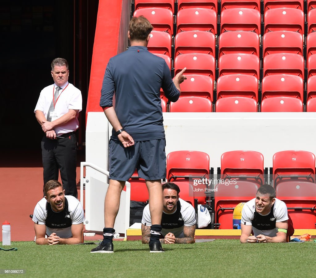 Jordan Henderson, James Milner and Danny Ings of Liverpool talking to Jurgen Klopp manager of Liverpool during the Training session at Anfield on May 21, 2018 in Liverpool, England.