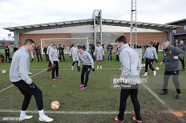 Jordan Henderson Joe Allen Adam Lallana and their teammates during a Training session at Melwood Training ground on February 18 2015 in Liverpool...