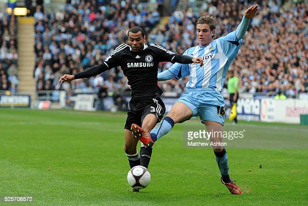 Jordan Henderson of Coventry City and Ashley Cole of Chelsea.
