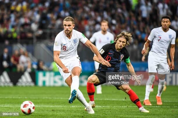 JOrdan Henderson of England and Luka Modric of Croatia during the Semi Final FIFA World Cup match between Croatia and England at Luzhniki Stadium on...