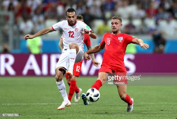 Jordan Henderson of England battles for possession with Ali Maaloul of Tunisia during the 2018 FIFA World Cup Russia group G match between Tunisia...