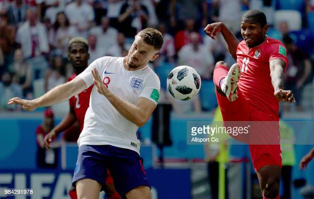 Jordan Henderson of England battles for the ball with Armando Cooper of Panama during the 2018 FIFA World Cup Russia group G match between England...