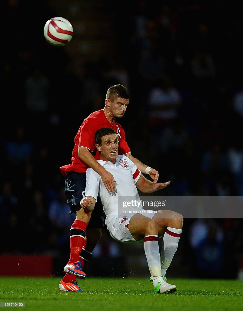 Jordan Henderson of England battles with Valon Berisha of Norway during the UEFA Under-21 EURO 2013 Group 8 Qualifier between England and Norway at Proact Stadium on September 10, 2012 in Chesterfield, England.
