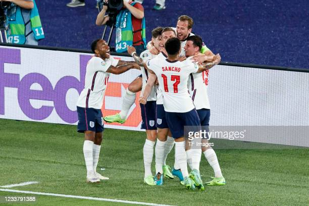 Jordan Henderson of England celebrates after scoring his team's fourth goal with teammates during the UEFA Euro 2020 Championship Quarter-final match...