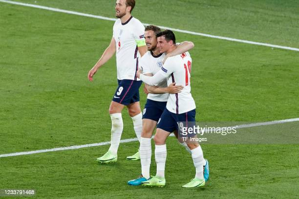 Jordan Henderson of England celebrates after scoring his team's fourth goal with Mason Mount of England during the UEFA Euro 2020 Championship...