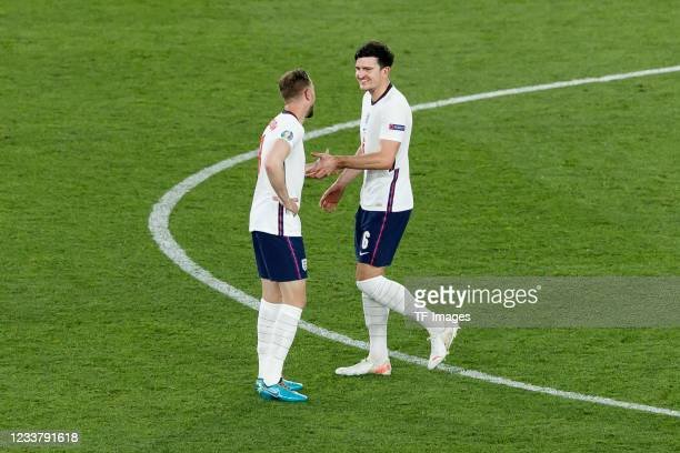 Jordan Henderson of England celebrates after scoring his team's fourth goal with Harry Maguire of England during the UEFA Euro 2020 Championship...