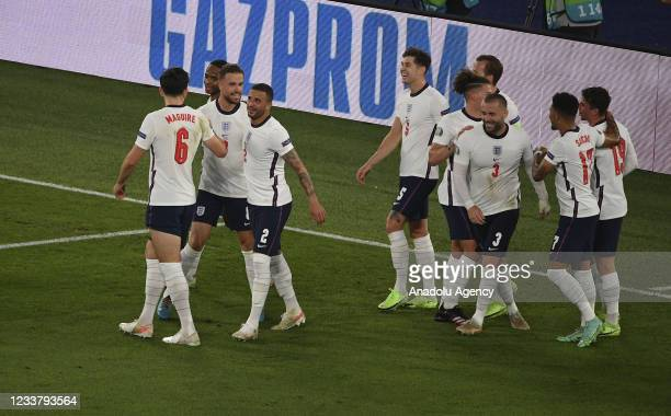 Jordan Henderson of England celebrates with his teammates after scoring during the UEFA EURO 2020 quarterfinal football match between Ukraine and...