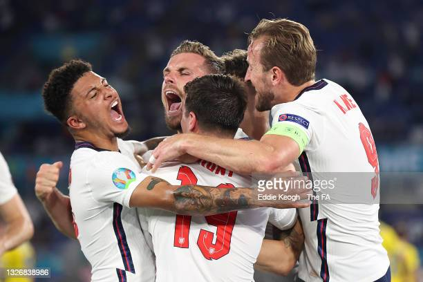 Jordan Henderson of England celebrates with Jadon Sancho, Mason Mount and Harry Kane after scoring their side's fourth goal during the UEFA Euro 2020...