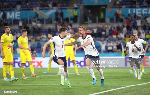 Jordan Henderson of England celebrates with John Stones after scoring their side's fourth goal during the UEFA Euro 2020 Championship Quarter-final...